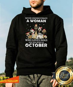 Never Underestimate A Woman Who Loves Dogs And Was Born In October Christmas Hoodie - Design By Fanatictees.com