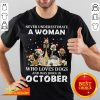 Never Underestimate A Woman Who Loves Dogs And Was Born In October Christmas Shirt - Design By Fanatictees.com
